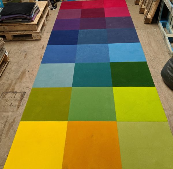 Various coloured, soft cut pile carpet tile