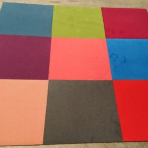 Mixed cut pile carpet tiles in various colours